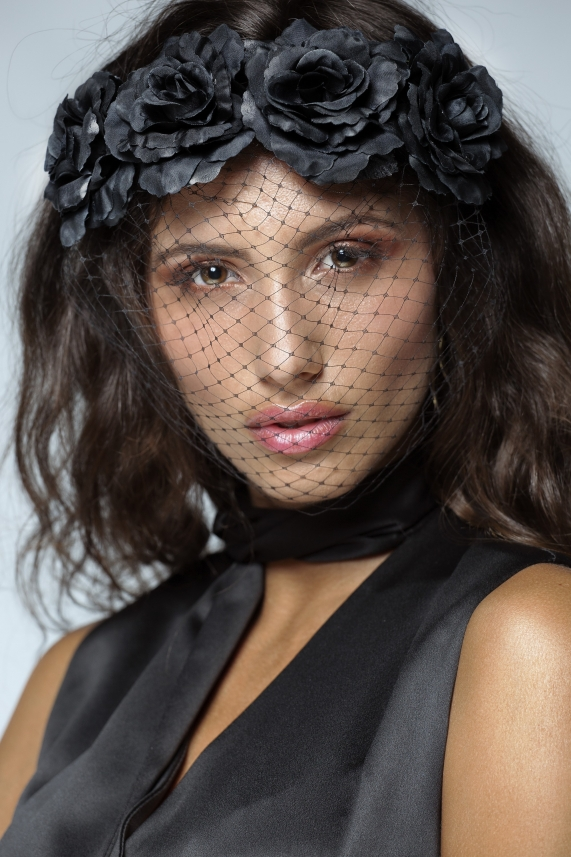 Black floral headband with a veil